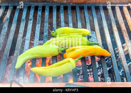 Cooking Xcatik peppers on a wood fired oven - Stock Photo