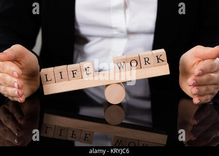 Life And Work Blocks Balancing On Seesaw - Stock Photo
