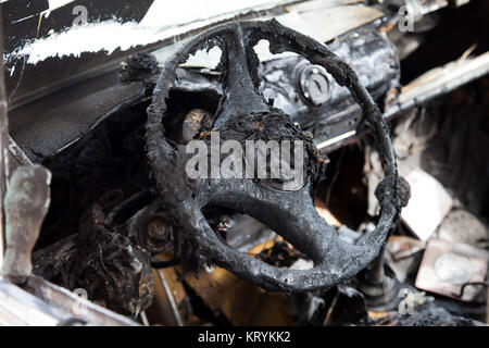 Wreck accident fire burnt wheel car vehicle junk - Stock Photo