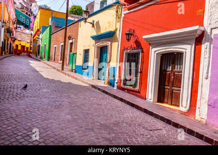 Red Pink Colorful Houses Narrow Street Guanajuato Mexico - Stock Photo