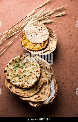 Assorted Indian Bread Basket includes chapati, tandoori roti or naan, paratha, kulcha, fulka, missi roti - Stock Photo
