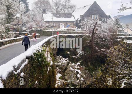 Pont-y-Pair old bridge circa 1470 over Afon Llugwy River in Snowdonia village with snow in winter December 2017. - Stock Photo