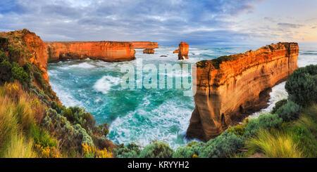 Twelve apostles marina park on Great Ocean road view towards razorback thin limestone rock cut off shipwreck coast - Stock Photo