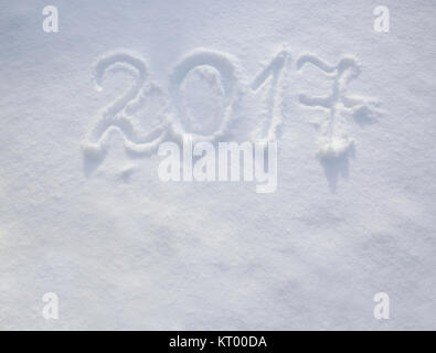 New years date 2017 written in fresh powder snow. New Year 2017 greeting, 2017 numbers written on snow field, greeting - Stock Photo