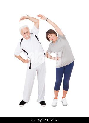 Active Senior Couple Doing Fitness - Stock Photo