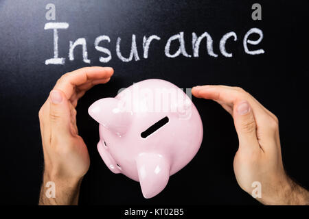 Close-up Of Insurance Concept On Blackboard - Stock Photo