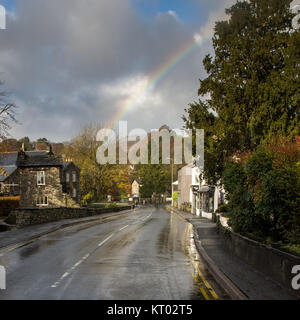 A rainbow over the A591 main road through Ambleside town in England's Lake District National Park. - Stock Photo