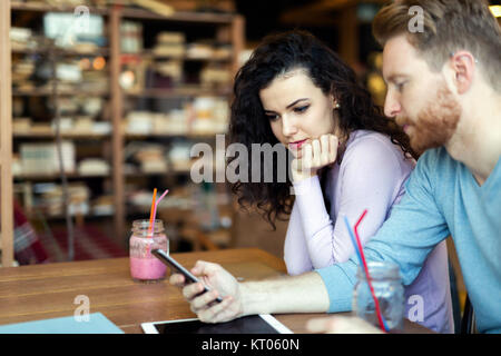 Young couple having date in coffee shop - Stock Photo