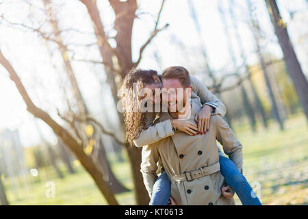 Young couple having romantic date in park - Stock Photo