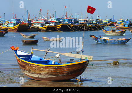 Many fishing boats line the shore of a village near Mui Ne in Vietnam South East Asia. - Stock Photo