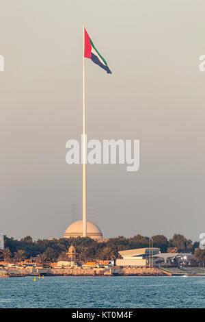 Giant flagpole with the UAE natinal flag in Abu Dhabi, United Arab Emirates - Stock Photo
