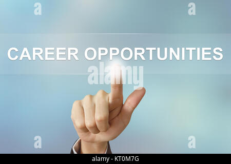 business hand clicking career opportunities button on blurred background - Stock Photo