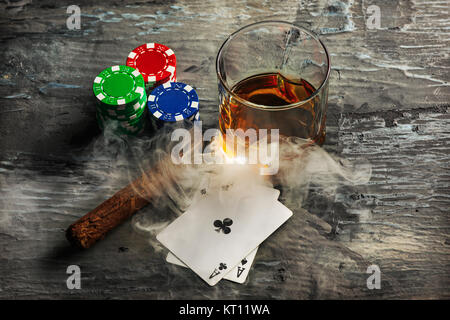 Cigar, chips for gamblings, drink and playing cards - Stock Photo