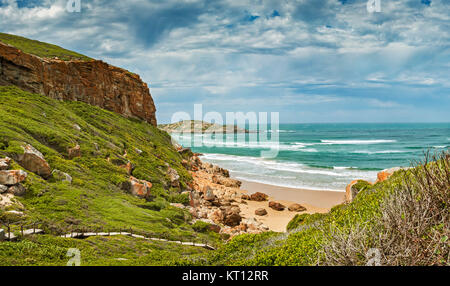 Tremendous Robbberg nature reserve coastline at Plettenberg bay South Africa. The photo shows a part of the wooden - Stock Photo