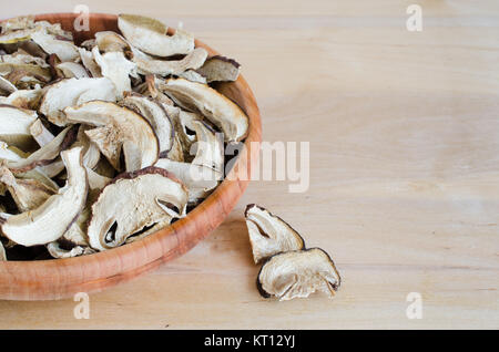 Dried porcini mushrooms on a wooden table. - Stock Photo