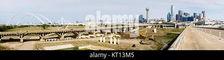 Bridges traverse the river and lead commuters into Dallas Texas - Stock Photo