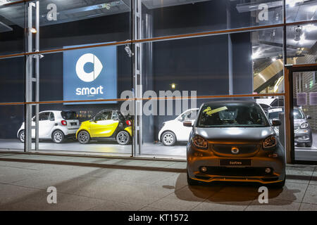 MUNICH, GERMANY - DECEMBER 11, 2017 : A Smart Fortwo car exhibited in front of the Mercedes Benz dealership building - Stock Photo