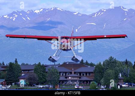 RUST'S FLYING SERVICE DHC-3T TURBO OTTER ABOUT TO LAND ON LAKE HOOD, ALASKA. - Stock Photo