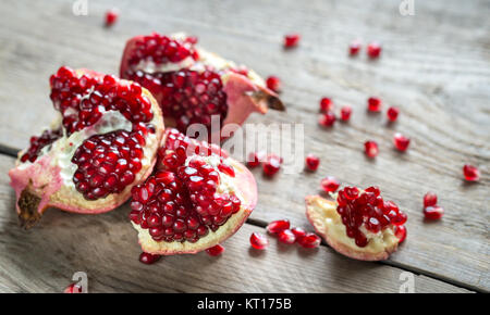 Pomegranate on the wooden background - Stock Photo