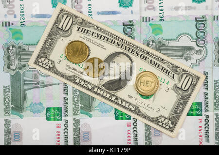 The coin with the inscription no and the euro are on the bill of ten dollars which lies on a pile of thousand-Russian - Stock Photo