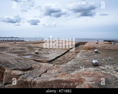 Oresund (The Sound) strait with the Oresund brige on the horizon and with the Malmo City coast in the foreground - Stock Photo