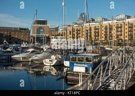 Luxury Boats Moored and Docked in the Safety of St Katharine Dock with Reflections on Water Tower Hamlets London - Stock Photo