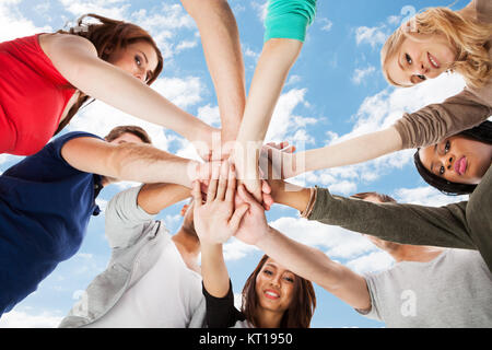 Young College Students Stacking Hands - Stock Photo
