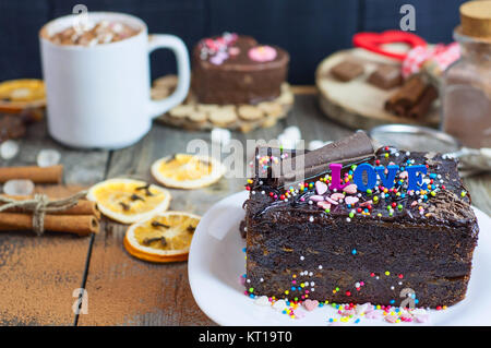 piece of chocolate cake on a white plate Sacher - Stock Photo
