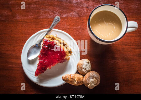 A delicious slice of cheesecake with coffee and bread - Stock Photo