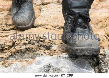 Trekking leather boot on the rock - Stock Photo