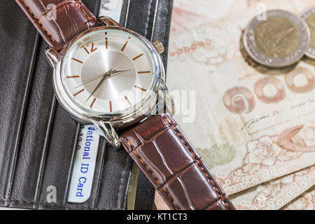 Watch and wallet on banknote - Stock Photo