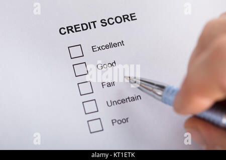 Person Filling Credit Score Form - Stock Photo