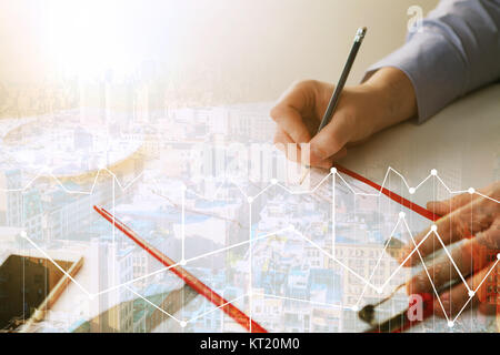 The male hand drawing a graph of growth - Stock Photo