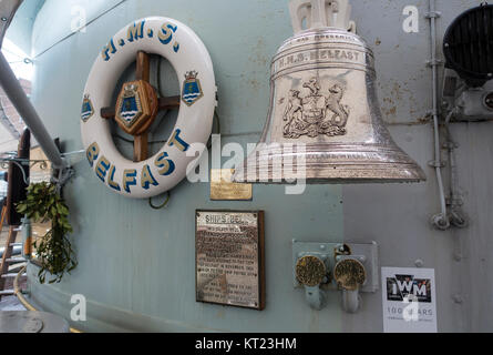 The Silver Ships Bell on HMS Belfast Moored in the River Thames part of Imperial War Museum Collection London England - Stock Photo