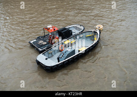 Two Livetts Safety Boats Artemis and Lima Lima Moored in the River Thames near HMS Belfast London England United - Stock Photo