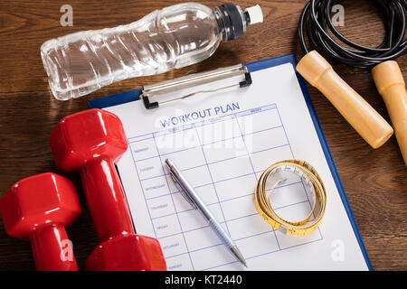 Workout Plan Form With Fitness Equipments - Stock Photo
