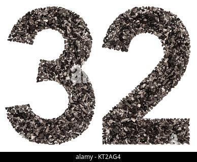 Arabic numeral 32, thirty two, from black a natural charcoal, isolated on white background - Stock Photo