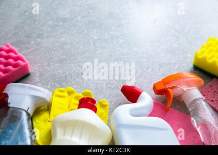 Cleaning products on stone background with copyspace. top view - Stock Photo