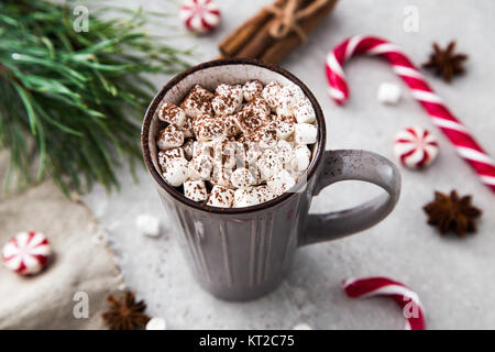 Cocoa with marshmallow and christmas decoration. On a stone background. - Stock Photo