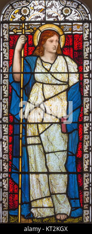 LONDON, GREAT BRITAIN - SEPTEMBER 17, 2017: The symbolic cardinal virtue of Faith on the stained glass in church - Stock Photo