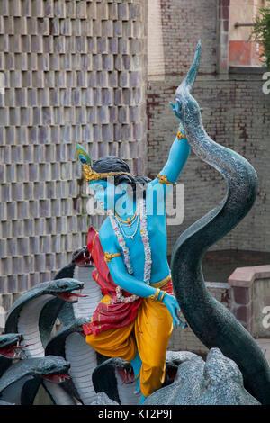 Lord Krishna and Kalia Naag statue, Sri Sri Radha Parthasarathi Mandir ISKCON temple - Stock Photo