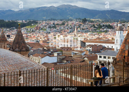 A couple enjoying the view from the roof of the Cathedral, Cuenca cathedral, Cuenca, Ecuador South America - Stock Photo
