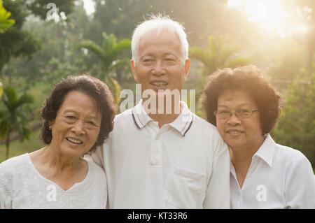 Asian seniors group having fun - Stock Photo