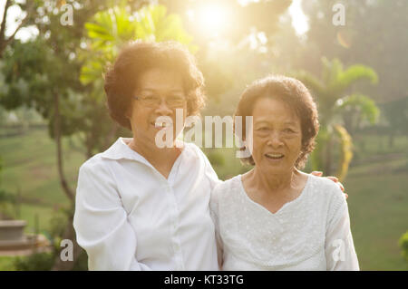 Asian seniors family having fun - Stock Photo