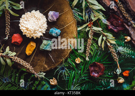 Rainbow of Crystals in order of Chakras with Botanicals - Stock Photo