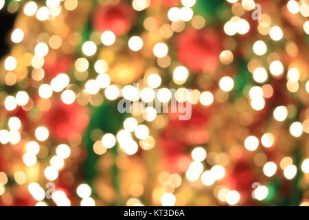 Christmas tree on abstract light golden bokeh background. - Stock Photo