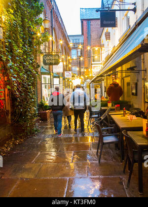 View along the wet pavements of the medieval godstall lane that links the city centre with the cathedral in the - Stock Photo