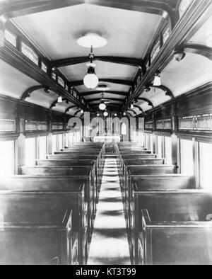 Interior of St Paul Catholic railroad chapel car - Stock Photo