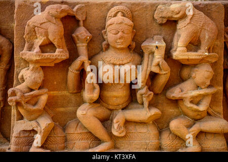Intricate stone Sculpture detail of a temple, Khajuraho, Chhatarpur District, Madhya Pradesh, India - Stock Photo