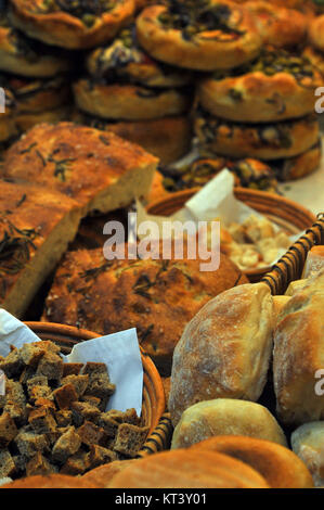 a selection of artisan breads cooked and baked at a stall on borough market in Southwark, London bridge. Bakery - Stock Photo